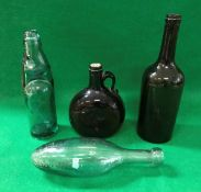 A 19th Century green glass bottle, together with a reddy brown spirit decanter,