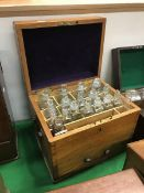 An early 20th Century ash-cased apothecary's chest,