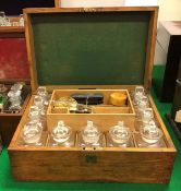 A late Victorian oak-cased apothecary's chest of rectangular form,