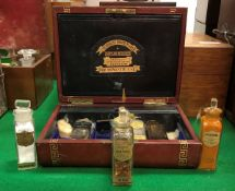 A Victorian leather-covered travelling apothecary's chest with tooled and gilded greek key banding,