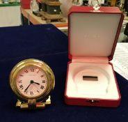 A Cartier travel clock, 24 carat plated,