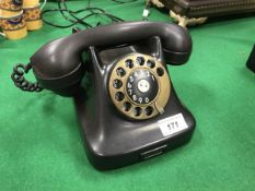 "A vintage GPO black bakelite cased telephone No'd to base ""213.251B-F."