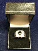 A gentleman's 9 carat white gold onyx and diamond set ring,