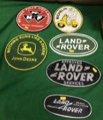 """A collection of six painted metal signs """"Nothing Pulls Like a Massey"""","""
