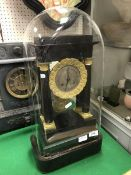A 19th Century French ebonised and gilt brass cased clock of architectural form,