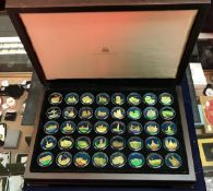 A Birmingham Mint cased set of silver medallions with later hand-enamelled decoration,