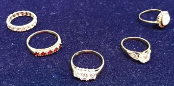 A collection of five various gold stone set dress rings,