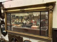 A Victorian gilt framed over mantel mirror with acanthus capped column decoration