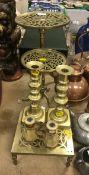 An early 19th Century brass tripod trivet another similar smaller, a square pierced brass trivet,