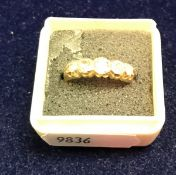 An 18 carat gold and five stone set diamond ring approx.