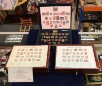 "A cased set of gold plated silver stamps ""Replicas of the Empire Collection"" produced by Hallmark"