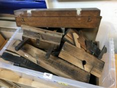 A collection of various vintage woodworking tools including a plough plane, another plane by W.