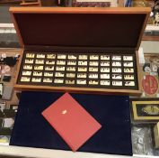 "A cased set of silver ingots depicting ""A Thousand Years of The British Monarchy"", No'd."