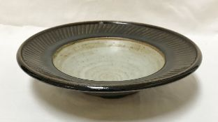 DAVID LEACH (1911-2005) - a fluted stoneware dish, impressed potter's mark under glaze to base,