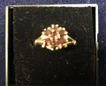 A 9 carat gold garnet cluster ring, approx 4.
