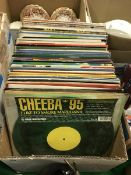 A box containing various mainly twelve inch singles,