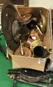 A box of metal wares to include a gilt candlestick with scrolling decoration,