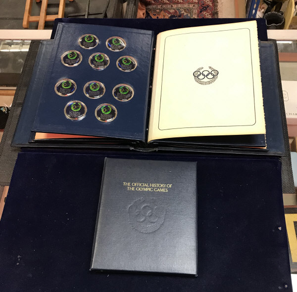 """Lot 208 - A cased set of 50 silver limited edition proof set medallions entitled """"The Official History of The"""