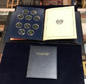 "A cased set of 50 silver limited edition proof set medallions entitled ""The Official History of The"