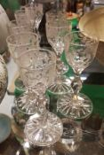 A set of eight 19th Century cordial glasses, the bowls decorated with symbols of the Empire, rose,
