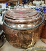 A Victorian copper cauldron and cover with iron swing handle