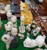 A collection of thirteen various pottery cat ornaments by Plichta,