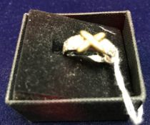 An 18 carat gold cross decorated and diamond set dress ring, approx 9.