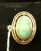 A 9 carat gold dress ring set with oval turquoise, approx 6.