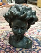 """ROLAND MOLL """"Arabella"""" a bronzed cold cast bust of a young child with flowing hair,"""
