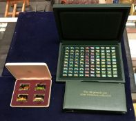 "A cased set of ""100 Greatest Cars Silver Miniature Collection"" by John Pinches with later coloured"