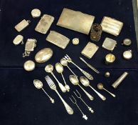 A collection of silver wares to include vesta cases, sovereign holder, cigarette case, cutlery, etc,
