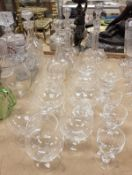 A pair of late Victorian etched and cut glass decanters of onion form,