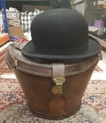 A bowler hat by Moores & Sons Ltd of London in leather hat box