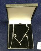 A diamond pendant and earring set