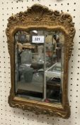 A 19th Century gilt and gesso framed mirror mounted on easel back
