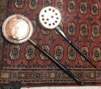 A copper warming pan with ebonised turned wood handle and another copper warming pan with engraved