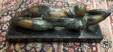A verdigris patinated bronze study of a recumbent nude in the manner of Henry Moore apparently