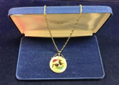 A 1887 Victorian gold £5 coin with 9 carat gold mount and chain and later coinamell decoration