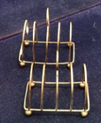 A pair of four section silver toast racks (Birmingham 1925) approximately 3 oz