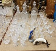 A group of five various 19th and 20th Century cut glass decanters together with various cut wine