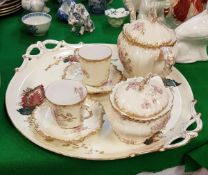 A Limoges rose and gilt decorated tête-à-tête teaset (no jug) on an associated two handled tray
