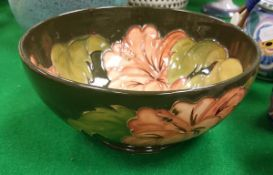 A Moorcroft green ground floral decorated bowl bearing impressed and signed marks to base