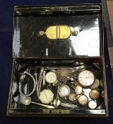 A tin containing various wrist and pocket watches to include 9 carat gold cased wristwatch,
