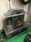 A Victorian black marble cased mantle clock of architctural form,