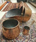 A copper coal scuttle,