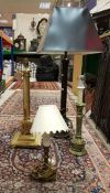 A pair of modern brass reeded column table lamps,