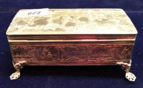 A white metal embossed box decorated with figures and dogs,
