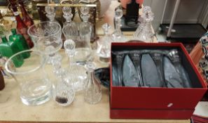 A collection of seven modern cut glass decanters together with a modern tantalus and various other