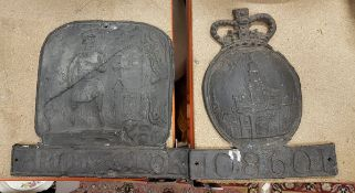 """Two cast lead fire marks, one """"protector"""" decorated with firemen and blazing house,"""