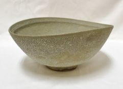 CHRIS CARTER (Born 1945) - a thrown and altered footed bowl with oxidised glaze,